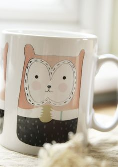 """Squirrel Mug  6.00 GBP   By Jilly Bird   """"Our Squirrel Mug is coloured in pale rose pink, pistachio and dark damson. It would be a perfect mug for a hazelnut flavoured hot chocolate best sipped whilst sitting in a tree!! Let's just say it's a fun cup for fancy tipple."""""""