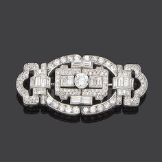 An art deco diamond brooch, circa 1930 The openwork panel brooch of geometric design, set throughout with brilliant, baguette and single-cut diamonds, to a central collet-set brilliant-cut diamond, principal diamond approx. 0.90ct., remaining diamonds approx. 5.20ct. total, length 6.0cm.