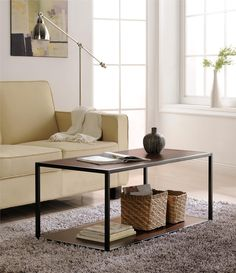 Open up your living room with the addition of the Ameriwood Home Canton Coffee Table with Metal Frame. With an industrial style, this minimalistic table is designed to make your room feel airy and uncluttered. The top surface is great for coasters and decorative items, while the bottom shelf keeps books and magazines within reach. Because the gunmetal gray finish covers all 4 sides, the table can be placed virtually anywhere within the room. Minimal assembly is required for this unit, which…