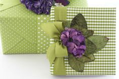 Stunning green and white striped wrapping paper topped with purple - Carolyne Roehm <3. #gifywrapping #elegant #greenpurple