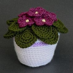 African Violets crochet pattern : PlanetJune Shop, cute and realistic crochet patterns & Adorable crocheted African violets in a pot. I might make this for an aunt who loves African Violets African Violets by June Gilbank Reminds me of my grandma. Vase Crochet, Cactus En Crochet, Crochet Puff Flower, Knitted Flowers, Crochet Flower Patterns, Crochet Home, Crochet Gifts, Crochet Designs, Knit Crochet