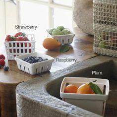 Reusable ceramic replicas of traditional farmers'-market baskets provide good air flow to keep fruit fresh.