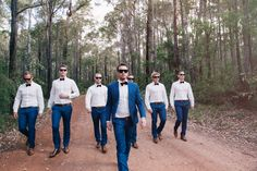 Wedding inspiration shoot of maroon bowtie, electric navy blue with white outfits for the the groom and groomsmen | For those who love a down-to-earth and enjoyable outdoor wedding, the wedding of Dave and Danielle will definitely win your heart over. See more of their playful wedding album here. on http://www.bridestory.com/blog/one-couples-sweet-and-playful-wedding-in-australia
