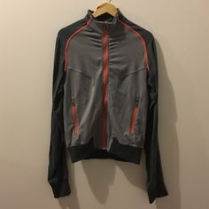 Lululemon track top jacket Gray and dark grey with pink piping. Interior label has been removed. There are some areas of pilling. One area by back logo. Another by pockets/ lower side back. Can provide more pictures of requested. lululemon athletica Jackets & Coats Utility Jackets