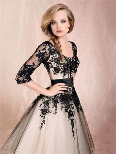 Black lace on tan/champagne dress.