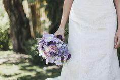 A bride holding a colorful bouquet - Design Pics Inc/Rex Features