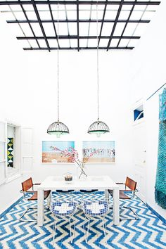 Dining room, Popham Design tiles, Bertoia chairs, leather modernist chair, blue tiles