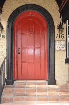 Red doors seem so inviting!  I'm going to paint my front  back doors and my shutters red. :)