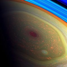 False-color image from NASA's Cassini mission highlighting storms at the north pole of Saturn.