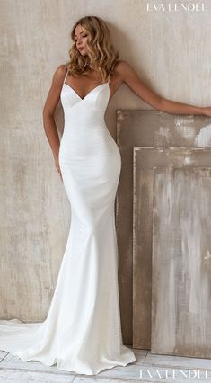 Simple mermaid wedding dress with contemporary silhouette, v-neckline and spaghetti straps for the minimalist bride Sparkly sexy contemporary bridal gown style | Eva Lendel Wedding Dresses 2021- Less is More Collection -Daniel - Belle The Magazine See more gorgeous bridal gowns by clicking on the photo
