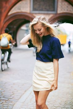 This is cute. Loose navy tshirt top and white pencil skirt