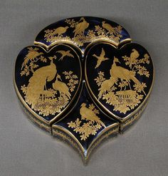 Toilet box containing four smaller boxes Chelsea Porcelain Manufactory ca. 1761  British, Chelsea Soft-paste porcelain, Mazarin blue ground with gold decoration Dimensions: greatest ht: 6 1/2 x greatest w: 5 3/4 in. (16.5 x 14.6 cm)