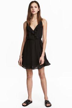 Kopertowa sukienka z falbanami - Czarny - ONA | H&M PL 1