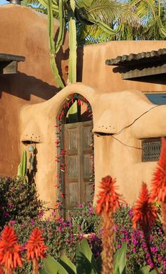 Southwest-Style Pueblo Desert Adobe Home. The difference between cob and adobe is the simple difference between making mud bricks first, or simply building with clay mud directly.  ~ Raederle http://www.raederle.com