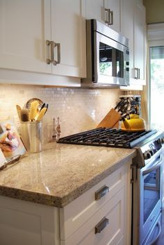 mini subway tile with granite countertops  is a great idea for a kitchen backsplash