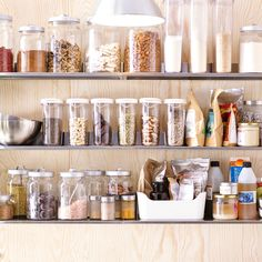 One of the most important items in a raw food kitchen is storage containers. Glass and plastic containers work great for helping your staple ingredients like nuts, seeds and spices stay fresh longer. And glass jars are essential for fermenting and sprouting foods. We like the idea of using open shelves to keep it all close to hand.
