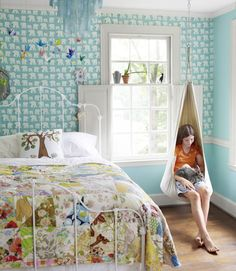 A colourful teal children's bedroom with quilt