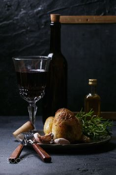 Roasted chicken - Roasted chicken served with wine, herbs and garlic. Dark Rustic style. Copy space