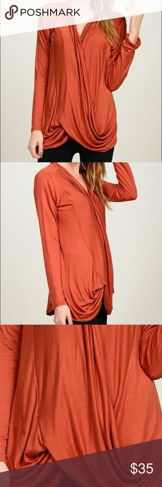 """Coming. Bellino Surplice Top Stunning.  Well made. Perfect Rust Color. Totally """"in"""" color for the season and very flattering. Perfect for holiday parties. Soft and flowing fabric. Forgiving fit. Sizes L and XL.  97% Rayon and 3% Spandex. Bellino Clothing Tops Blouses"""