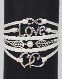"Our popular leather wrap bracelets - this one features the infinity symbol, the word ""Love"", wings, and entwined hearts. White with silver.  If this ModWrap notes ""Available on backorder"", you will receive it in 1-2 weeks."