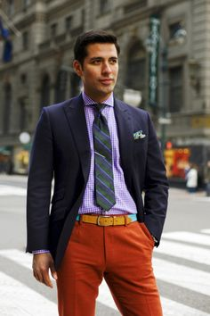 An orange pant, purple gingham shirt, striped rep tie, and a navy blazer