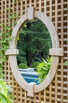 Strategically placed mirror reflects the landscape while implying a depth beyond  French Country  American  TraditionalNeoclassical  Grounds  Garden  Architectural Detail by Dan Gordon Landscape Architects
