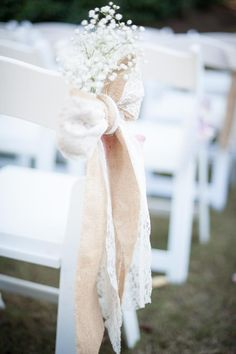 Burlap and lace aisle bows and then bring them to the reception for the reserved tables