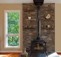 Image result for stacked stone wall behind wood stove