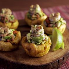 Shrimp and avocado stuffed plantain cups are hand-held bites of zesty heaven. Impress your guests with these tropical appetizers!