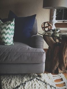 Gray couch, driftwood side table and souk rug. Brian Paquette Interiors – Gallery