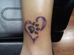 Ankle Heart with Paw Print Tattoo!! Tempted to get one one day for Dottie once she passes away