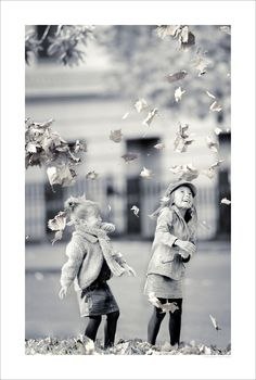 It's funny how a still shot of action is frozen and moving at the same time. Autumn Leaves, sisters portrait >by Tilnak 2009