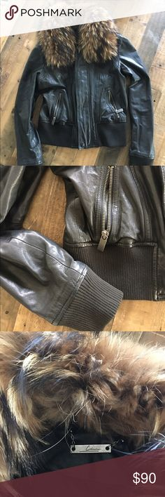 Leather Bomber Jacket with Fur Real leather and fur bomber jacket by Line. Fur is removable. Jacket is maybe 10 years old? In really good condition. Can't find the size, I wear a Small. 100% lambskin, fur is real asiatic raccoon line Jackets & Coats