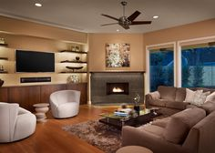 Sometimes the best way to deal with these two focal points is to separate them. This design makes great use of an angled wall while still making it easy to enjoy the fireplace and TV at the same time.