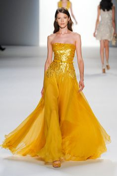 Elie Saab Spring 2012 Fashion Week!  I dont like the color, but the contrast of the elegant flowing skirt with the tight sequence top is a great combo!!