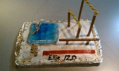 """Gymnastics birthday cake.   Uneven bars: butterscotch candy sticks for bars, pretzel rods for supports  Balance beam: pretzel rod """"glued"""" on top of pretzel rod pieces  Vault: fruit roll-up for running lane, granola bar """"glued"""" to pretzel rod pieces for vault  Floor: 2 graham crackers iced with blue icing (used the spray)  Then stick a Polly Pocket or small doll doing splits and give her a 10.0! (Our girl was turning 12 so we gave her a 12.0)"""
