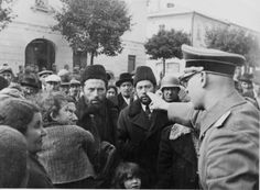 A German policeman harangues Jewish residents of an unidentified Ukrainian city. Note the expression of the small girl in middle foreground. Ukrainian Jews were among the first eastern Jews to be subjected to the Final Solution.