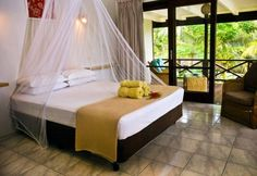 Vila Chaumières Restaurant & Resort is a beautiful resort with charming garden bures nestled amongst lush tropical gardens, from the city. Relaxing Holidays, Vanuatu, Romantic Getaway, Resorts, Sydney, Restaurant, Outdoor Decor, Furniture, Home Decor