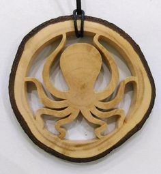Wooden Octopus Necklace Hand Carved Poulpe by Kvawoodjewellery