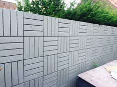 IKEA RUNNEN wall fence- great way to cover up neighbors fence and make it more cohesive if needed.