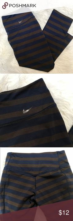 Nike Dri Fit S Cropped leggings they are chocolate and deep blue  They have a small flaw in the back as you can see in the pictures  Stretchy and soft (: Please see pictures Nike Pants Ankle & Cropped