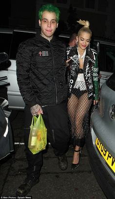 London pair: Rita and Ricky, pictured together in early October heading to Soho nightspot ...