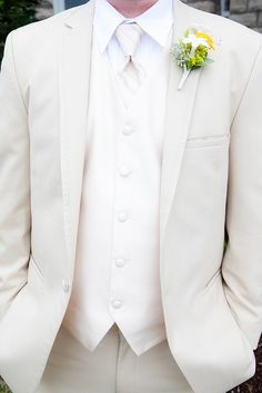 Ivory tux for the groom :] very nice. The groomsmen could be in traditional black :] that way he gets to stand out too!!