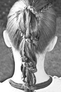 Carousel Braid @ Princess Piggies.  There's also a tutorial video on how it's done.