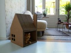 Modern cat house made of cardboard successfully replaced the cat tree