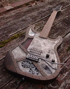 Cool Steam punk guitar. http://www.wishwall.me/c/steampunk-copper-colour-led-guitar-by-spookycat333-on-etsy-4f7088d9b233950ecd10ee30