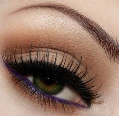 Neutral shadow with smoked out black liner along the upper lash line, falsies, purple waterline, and copper shadow along the bottom lashes with lots of mascara.