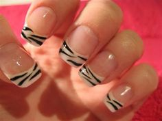 Zebra stripes inspired French manicure. The nails are initially coated in light pink base and tipped with thick white coat. Thin Zebra stripes are then drawn over the white tips; for the finishing touch the nails are coated in clear polish to preserve the design.