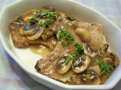 Pork Chops in Mushroom and Shallot Sauce.totally amazing and delicious. We used thickly sliced pork tenderloin from the freezer. We served with roasted brussels and roasted turnips, both of which were delicious! Pork Chop Recipes, Meat Recipes, Real Food Recipes, Cooking Recipes, Healthy Recipes, Roast Pork Chops, Smothered Pork Chops Recipe, Turkey Dishes, Pork Dishes