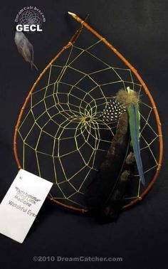 "These beautiful dream catchers are made for us by Tom ""Gray Elk"" Rael in the Cherokee style of dream catcher creation."